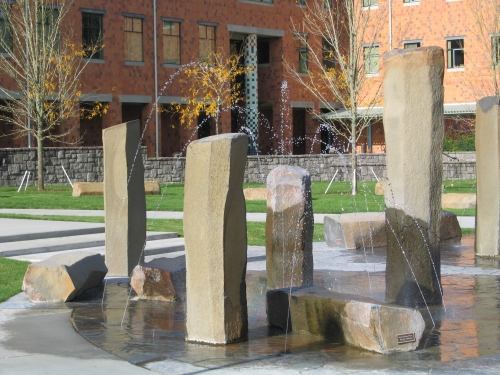 Columbia River basalts with clear stream and misting nozzles at WSU Vancouver Campus.